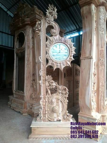 Jam Hias Jati Jepara Ukir Raflesia Rizki Raya Mebel toko online furniture Jepara berkualitas 085642641602